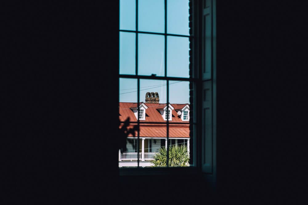 Charleston's architecture is best viewed through the sunny weather of summer. (Photo by Emma Frances Logan on Unsplash)